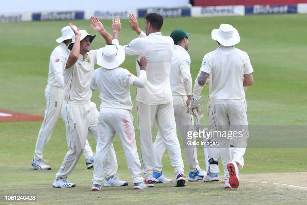 Duanne Olivier of the Proteas celebrates the wicket of Babar Azam of Pakistan with his team mates during day 2 of the 3rd Castle Lager Test match...