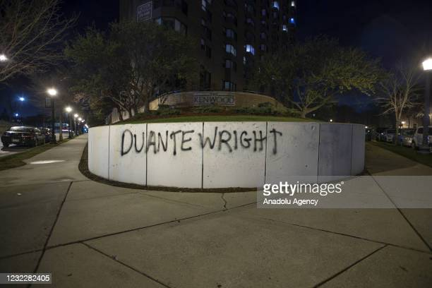 """Duante Wrigth"""" was spray painted on a wall next to a sidewalk as protests over police killing of Daunte Wright continue in Brooklyn Center,..."""