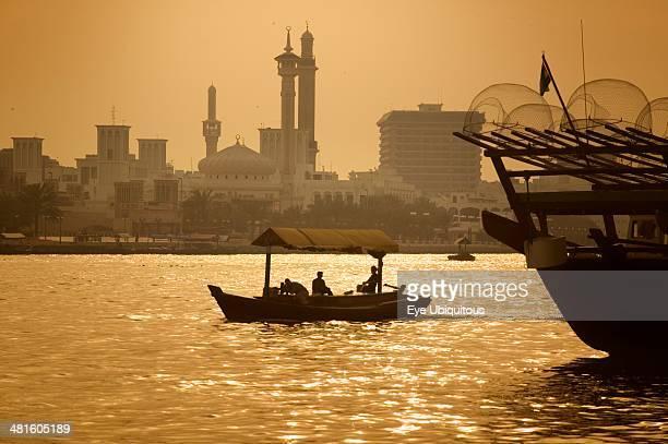 UAE Dubai Abra boat on Dubai Creek with the Grand Mosque behind