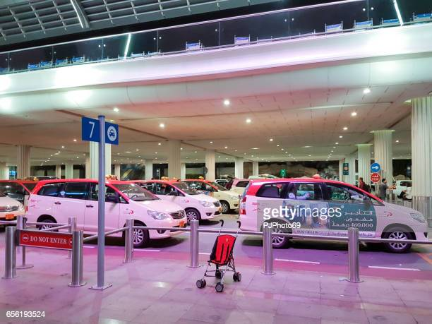 Dubai airport - Many cabs waiting customers at arrivals