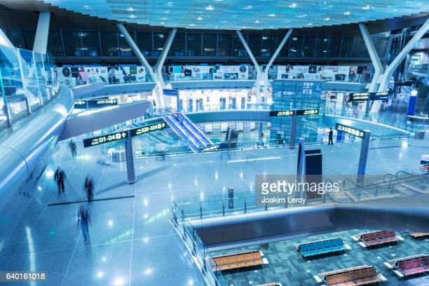 dubai airport terminal in blue tint mode - duty free stock pictures, royalty-free photos & images