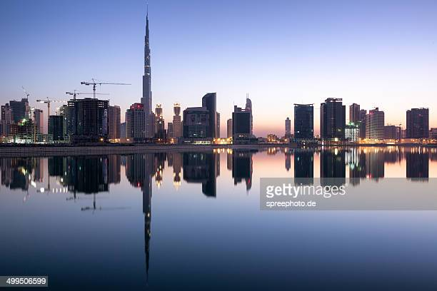 Dubai business bay skyline with water reflections