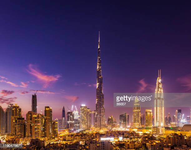 dubai city skyline at night, united arab emirates - financial district stock pictures, royalty-free photos & images