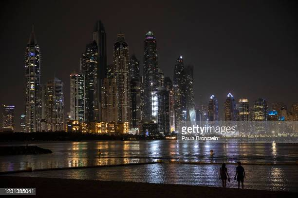 Dubai city skyline is seen from The Five hotel on The Palm on February 24, 2021 in Dubai, United Arab Emirates. Dubai is open for business, excepting...