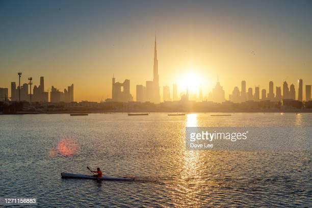 dubai city skyline - international landmark stock pictures, royalty-free photos & images