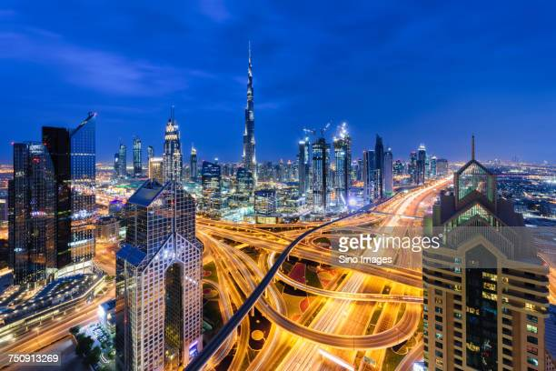 """""""dubai cityscape at night with highway overpass, united arab emirates"""" - image stock pictures, royalty-free photos & images"""