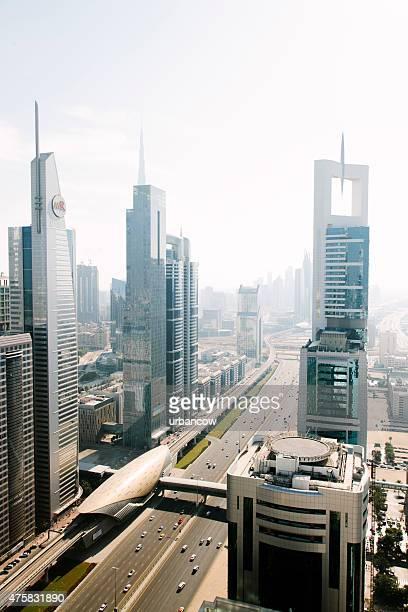 Dubai cityscape, multiple lane highway, subway station exterior, contemporary architecture
