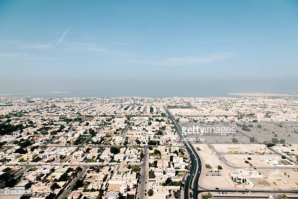 Dubai cityscape, residential district. Clear sky, daytime, aerial view