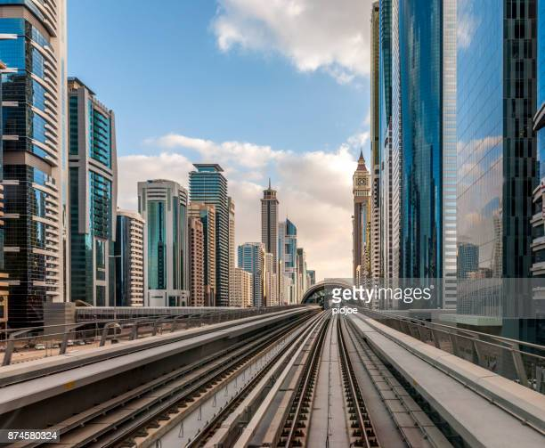 Dubai cityscape, view from driverless metro on cityscape of Dubai Downtown and Sheikh Zayed Road, United Arab Emirates