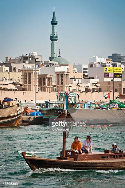 Dubai Creek abra ferry and minarets UAE
