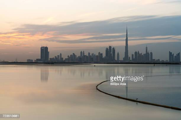 dubai creek in front of city skyline at dusk, dubai - image stock pictures, royalty-free photos & images