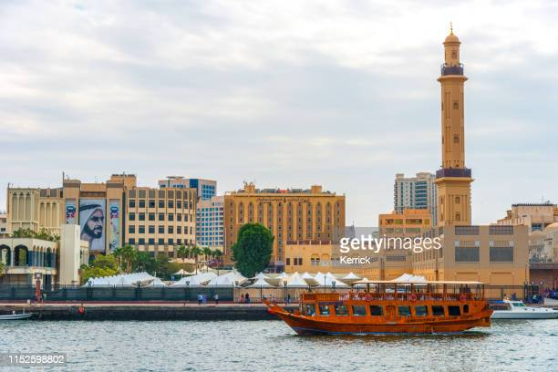 dubai creek - overlooking the grand mosque minaret - mosque stock pictures, royalty-free photos & images