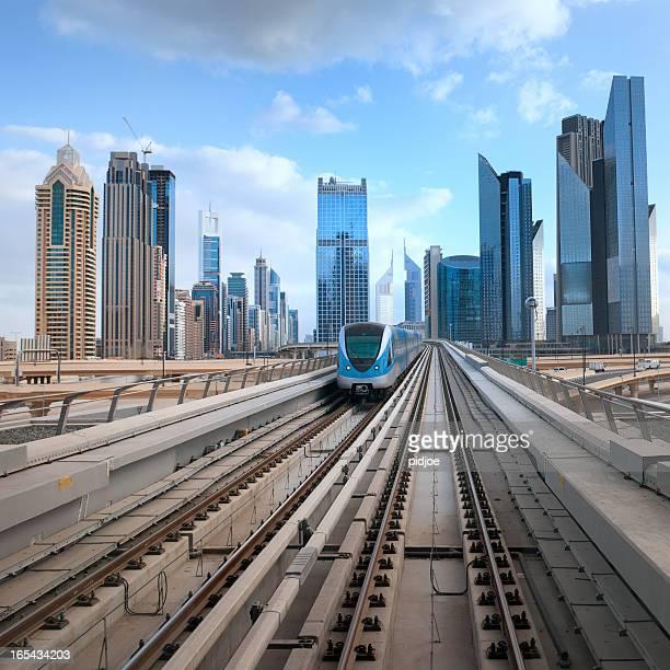 Dubai Downtown cityscape and subway train