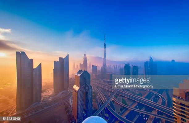 dubai downtown in fog - fog stock pictures, royalty-free photos & images
