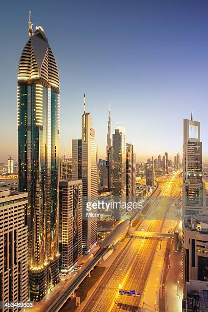dubai downtown modern skyscrapers twilight scene - jumeirah stock pictures, royalty-free photos & images