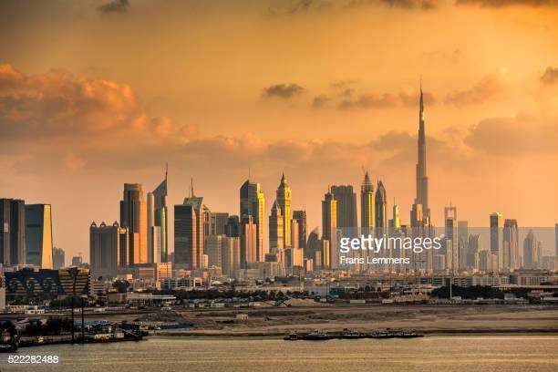 dubai, financial center skyline and burj khalifa - image stock pictures, royalty-free photos & images