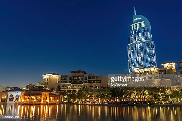 Dubai high rise hotel luxury apartments waterside restaurants at dusk