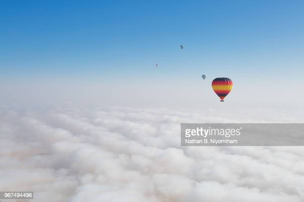 dubai hot air balloons in fog - high up stock pictures, royalty-free photos & images