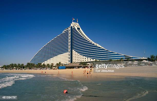 UAE Dubai Jumeirah Beach Hotel with people on private beach in foreground