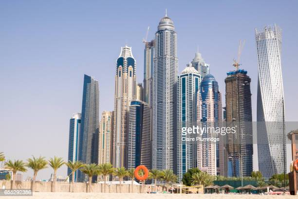 dubai marina buildings from the beach - claire plumridge stock pictures, royalty-free photos & images