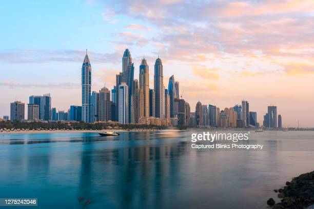 dubai marina from the sea side during sunset - united arab emirates stock pictures, royalty-free photos & images