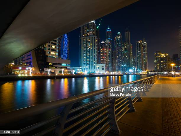 dubai marina, modern skyscrapers at night, united arab emirates - canal stock pictures, royalty-free photos & images