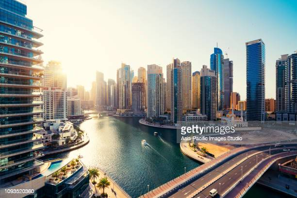 dubai marina skyline and modern skyscrapers at dawn - middle east stock pictures, royalty-free photos & images