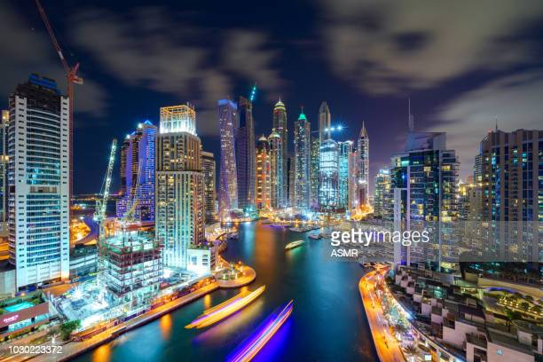 dubai marina skyline at night - gulf countries stock pictures, royalty-free photos & images