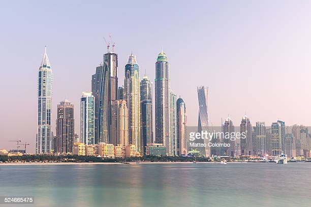 Dubai Marina skyline from the sea, at sunset