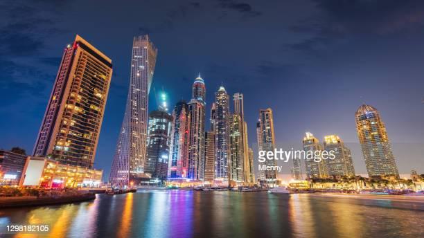 dubai marina skyline night panorama illuminated cityscape uae - mlenny stock pictures, royalty-free photos & images