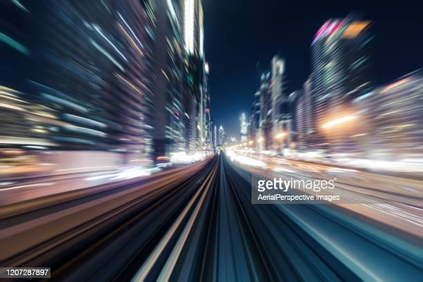 pov dubai metro passes through the city at night - autonomous technology stock pictures, royalty-free photos & images