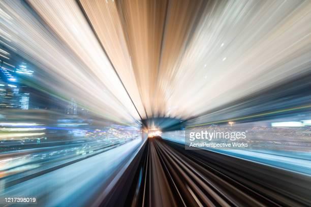 dubai metro riding through downtown at night - urban sprawl stock pictures, royalty-free photos & images
