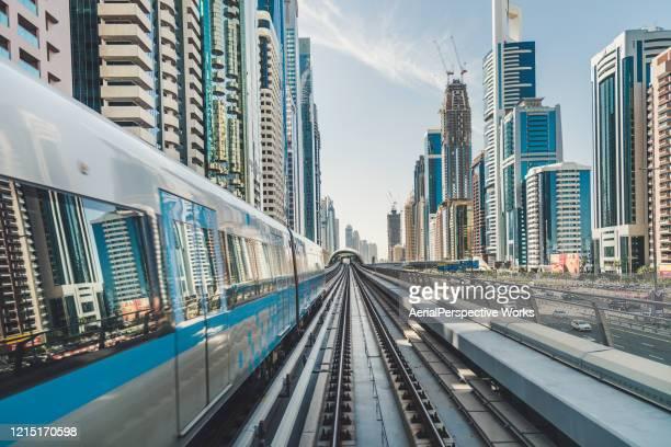 pov dubai metro riding through downtown - rail transportation stock pictures, royalty-free photos & images