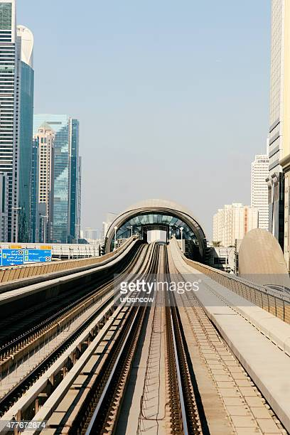Dubai metro station with apartment buildings and skyscrapers