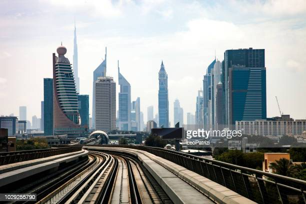 dubai metro subway station and city downtown skyline - gulf countries stock pictures, royalty-free photos & images