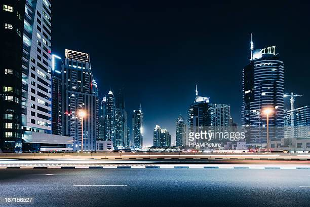 dubai night skyline - high street stock pictures, royalty-free photos & images
