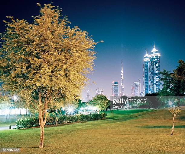 Dubai Park with city and Burj Khalifa at night