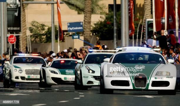 A Dubai police Bugatti leads a convoy of police vehicles a PorschePanamera a Lamborghini Aventador and a Bentley as they drive through the streets of...