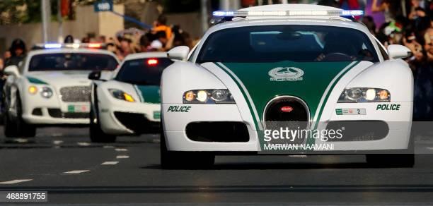 A Dubai police Bugatti leads a convoy of police vehicles a Lamborghini Aventador and a Bentley as they drive through the streets of downtown Dubai...