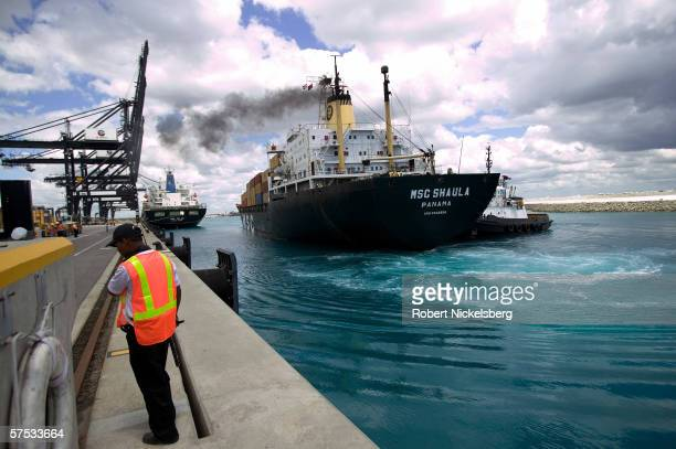 A Dubai Ports World Company security guard watches a ship docking at Puerto Caucedo facilities on April 2 2006 in the eastern outskirts of Santo...