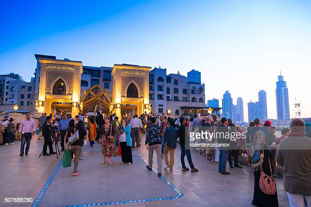 dubai shopping mall - crowds - visit stock pictures, royalty-free photos & images