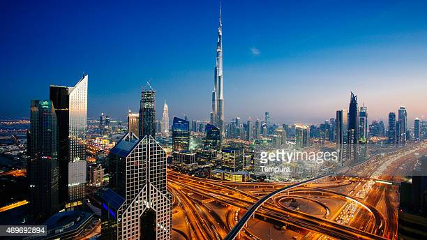 dubai sky line with traffic junction and burj khalifa - dubai stockfoto's en -beelden