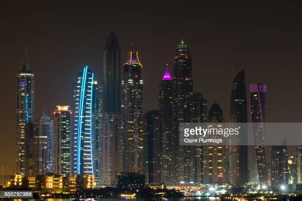 dubai skyline at night from the palm - claire plumridge stock pictures, royalty-free photos & images