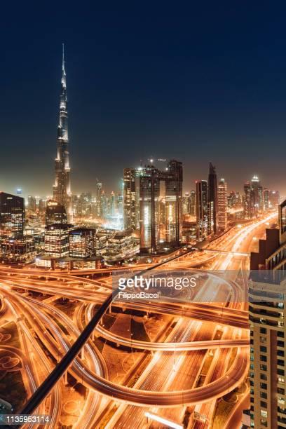 dubai skyline during sunset blue hour - burj khalifa stock pictures, royalty-free photos & images