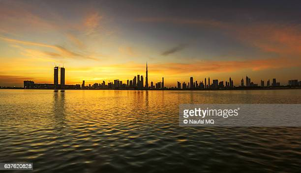 dubai skyline during sunset - canal stock pictures, royalty-free photos & images