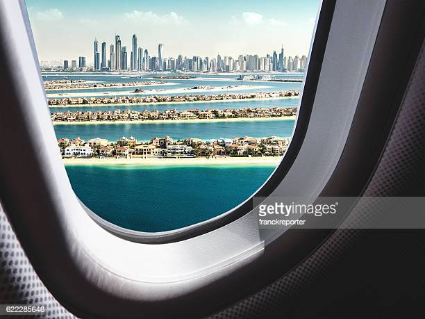 dubai skyline from the airplane - porthole stock photos and pictures