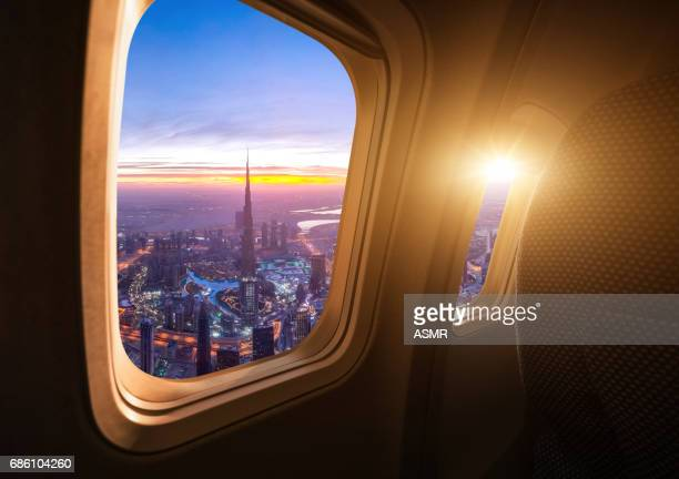 dubai skyline from the airplane - plane stock photos and pictures
