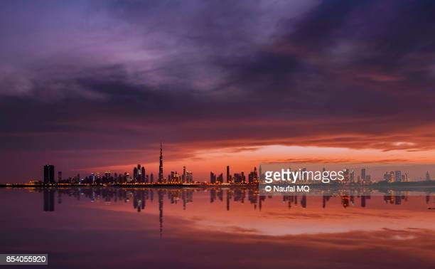 dubai skyline from the creek - financial district stock pictures, royalty-free photos & images