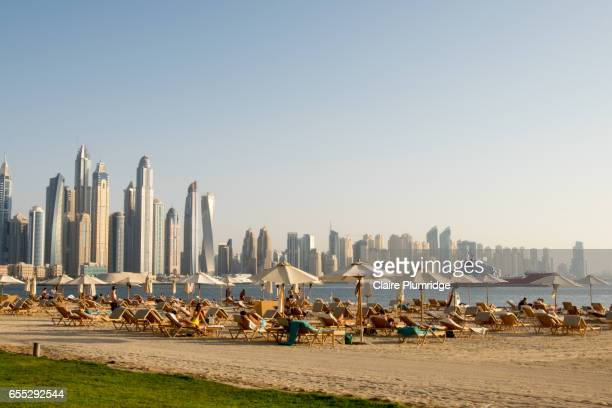 dubai skyline from the palm - dubai strand stock-fotos und bilder