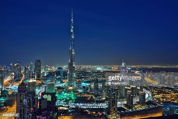 dubai skyline night - burj khalifa stock photos and pictures